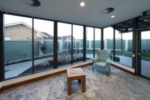 lounge room with glass wall